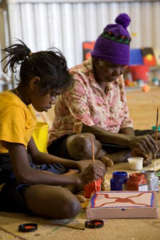An Indigenous child learning traditional painting at Martumili Arts Centre, 2009